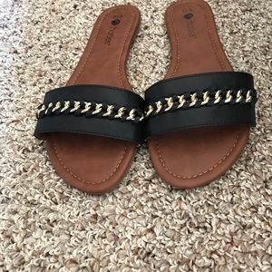black slide on shoes with gold chain detail size L
